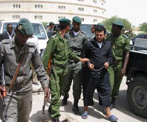 ولد السمان خلال اقتياده للمحاكمة 2007