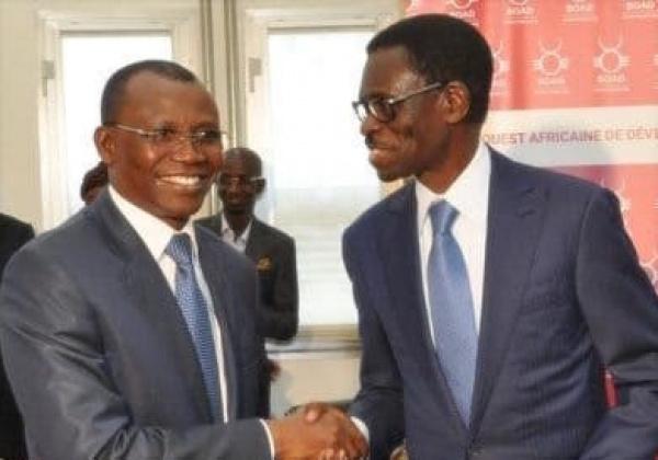 ساني يايا وزير الاقتصاد والمالية التوغولي، وكريستيان ٱدوفيلاندي رئيس البنك غرب الإفريقي للتنمية.