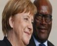 الرئيس البوركيني روك مارك اكريستيان كابوري، والمستشارة الألمانية أنجيلا ميركل.