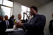 الرئيس الكونغولي منتهي الولاية جوزيف كابيلا لدى الإدلاء بصوته بكينشاسا.