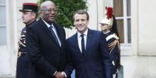 الرئيسان الفرنسي إيمانويل ماكرون والبوركيني روك مارك كريستيان كابوري.
