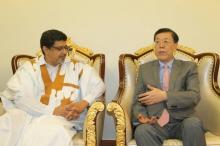 نائب وزير الخارجية الصيني لي جون، ورئيس حزب الاتحاد من أجل الجمهورية سيدي محمد ولد محم
