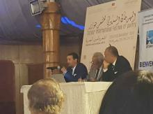 الدكتور محمد الأمين الشيخ أحمد على منصة أحد أنشطة المهرجان الشعري