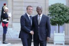 الرئيسان الإيفواري الحسن واتارا والفرنسي إيمانويل ماكرون