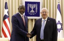 الرئيس الليبيري جورج ويا، والرئيس الإسرائيلي  رؤوفين ريفلين.